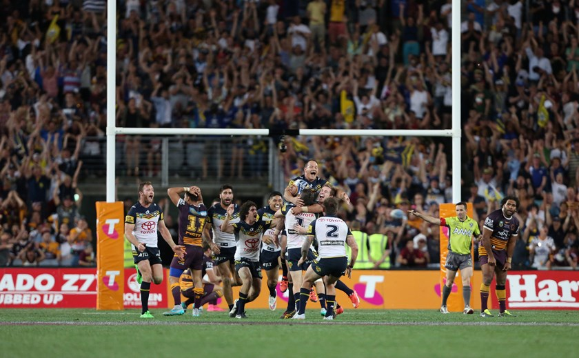 Cowboys players swamp Johnathan Thurston after the victory.