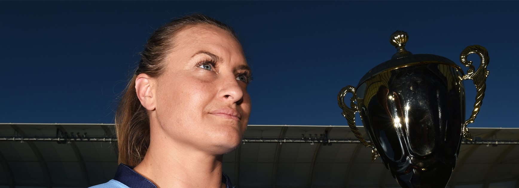 NSW women's star Ruan Sims with the Nellie Doherty Cup.