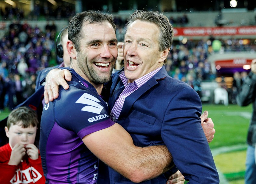 Cameron Smith and Craig Bellamy celebrate after winning the 2017 grand final.