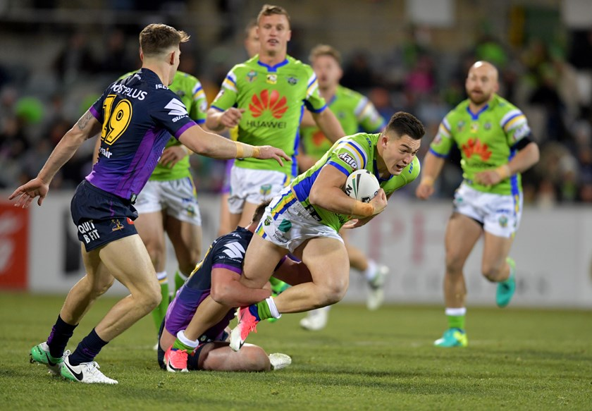Raiders winger Nick Cotric takes on the Melbourne Storm defence.