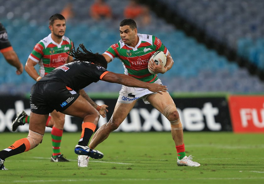 Greg Inglis takes on the Wests Tigers defence in round one of 2017.