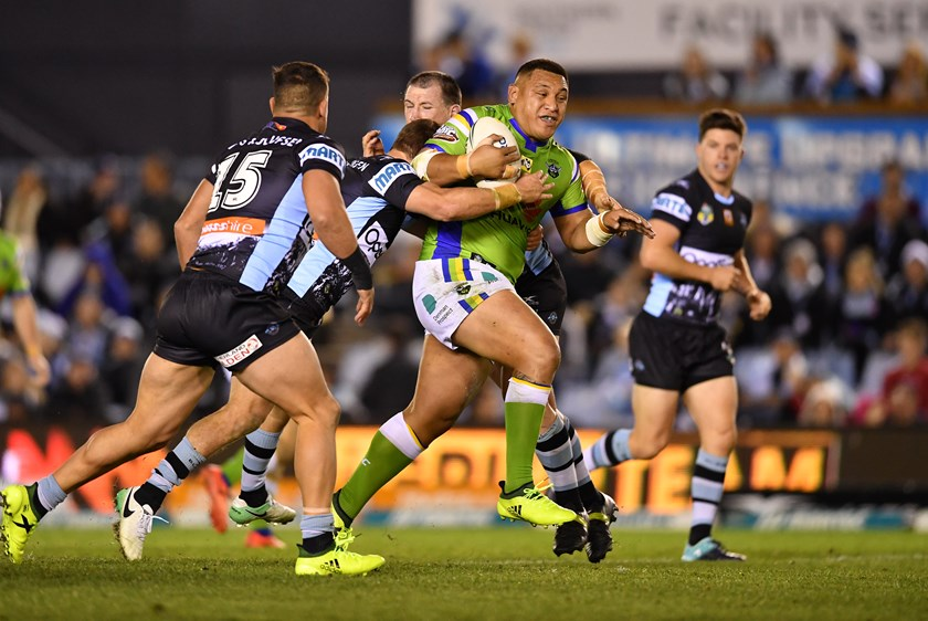 Raiders forward Josh Papalii takes on the Sharks defence.