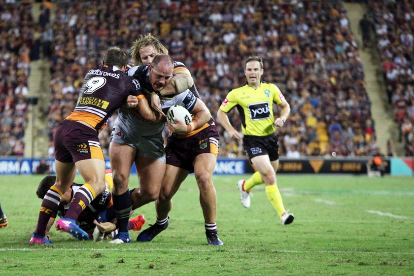 North Queensland Cowboys prop Matt Scott takes on the Broncos defence.