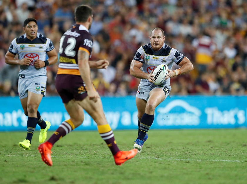 Matt Scott carts the ball ahead against the Broncos.