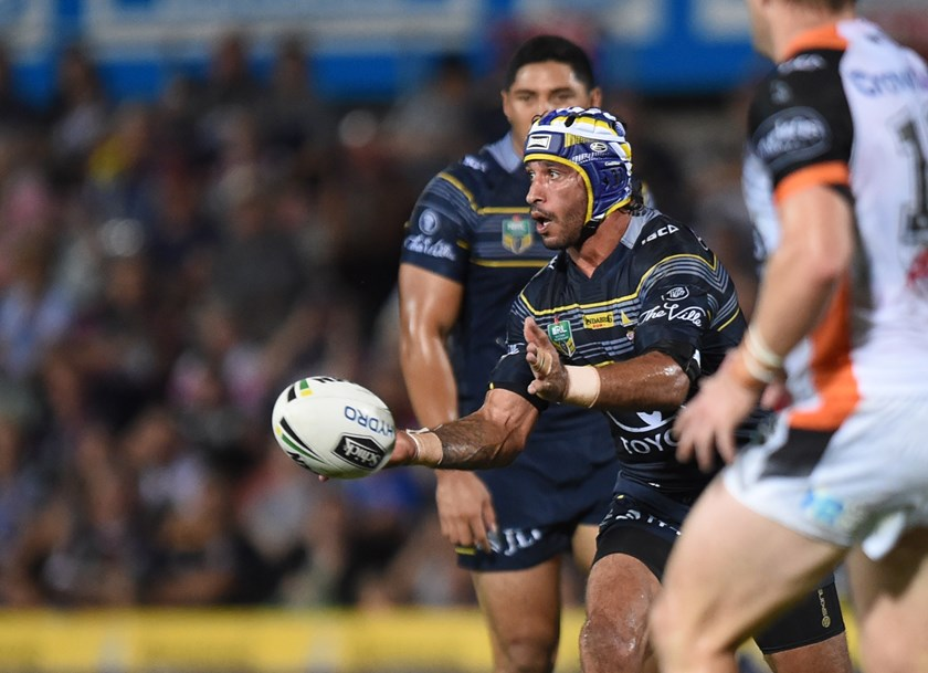 Johnathan Thurston gets a pass away against Wests Tigers.