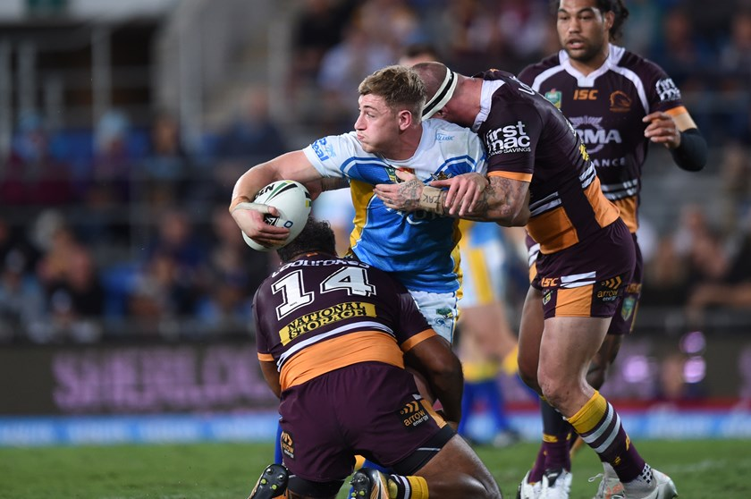 Titans forward Max King takes on the Broncos defence.
