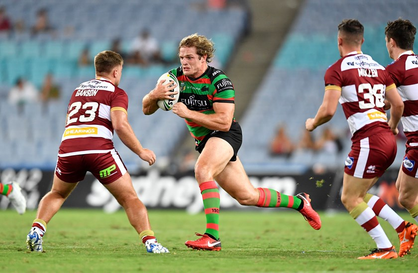 Rabbitohs prop George Burgess takes a charge against Wigan.