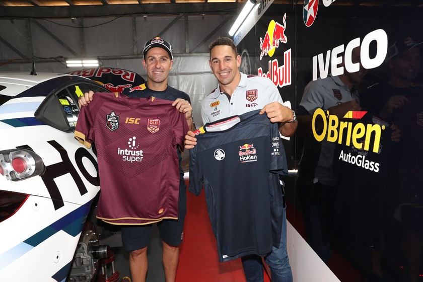 Jamie Whincup and Billy Slater swap shirts in Melbourne.