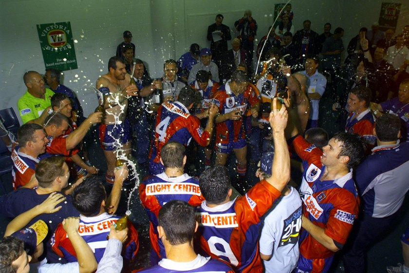 Knights players celebrate their 2001 grand final win.
