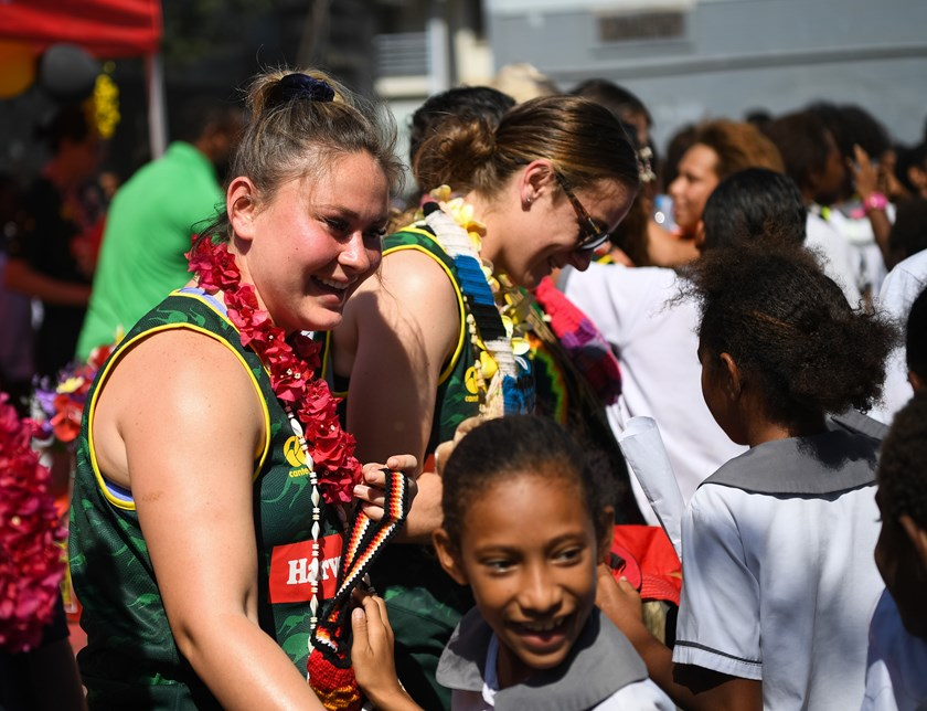 Members of the women's PM's XIII with students in Papua New Guinea.