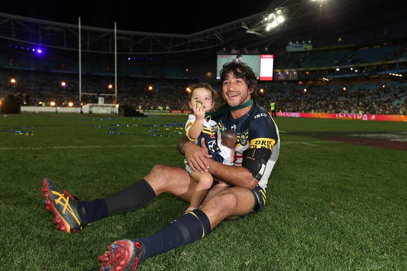Johnathan Thurston and daughter Frankie after the 2015 grand final.