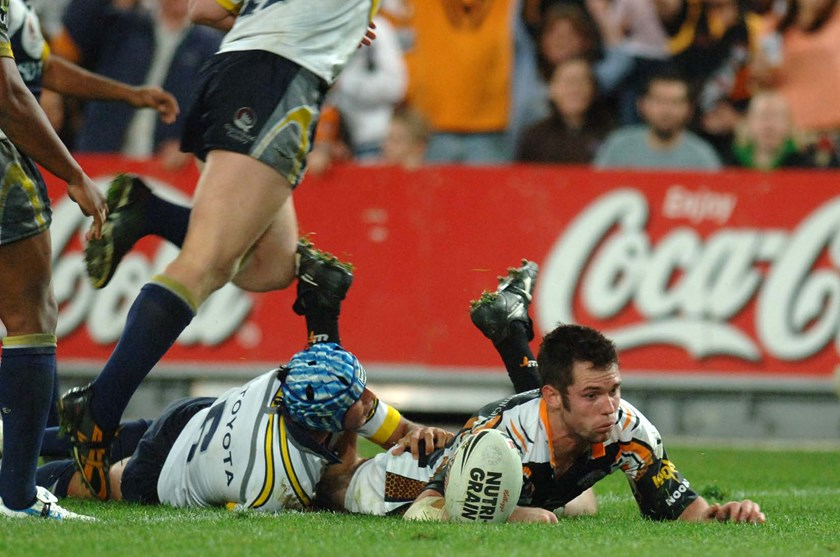 Wests Tigers winger Pat Richards scores a try against the Cowboys at ANZ Stadium.