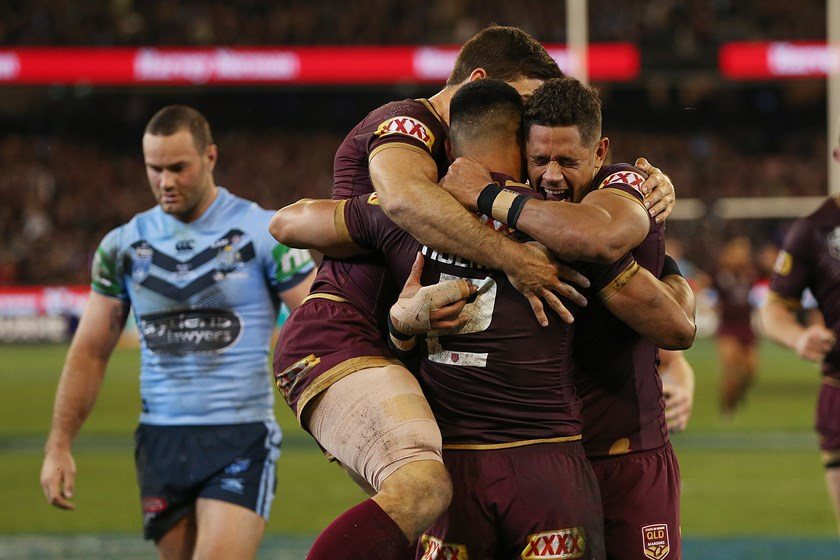 Queensland celebrate Valentine Holmes' try.