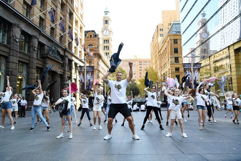 Trent Merrin and his dancing partners at Martin Place.
