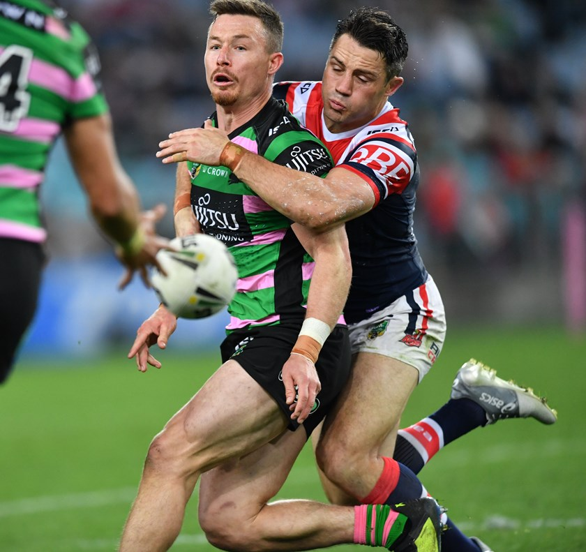 Roosters halfback Cooper Cronk (right) wraps up Rabbitohs hooker Damien Cook.