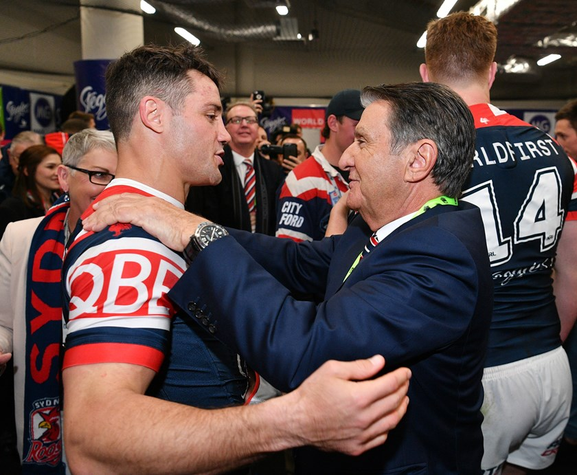 Cooper Cronk and Roosters chairman Nick Politis after the 2018 grand final.