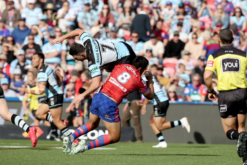 Sharks halfback Chad Townsend is upended.