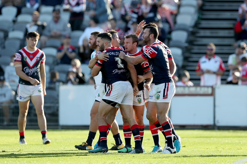 The Roosters celebrate a James Tedesco try.