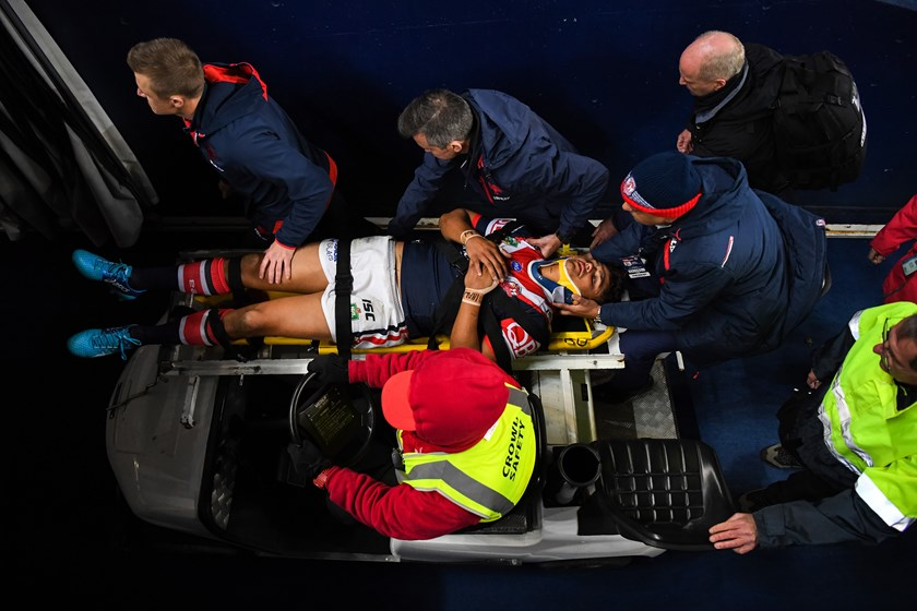 Sydney Roosters centre Latrell Mitchell is taken from the field.
