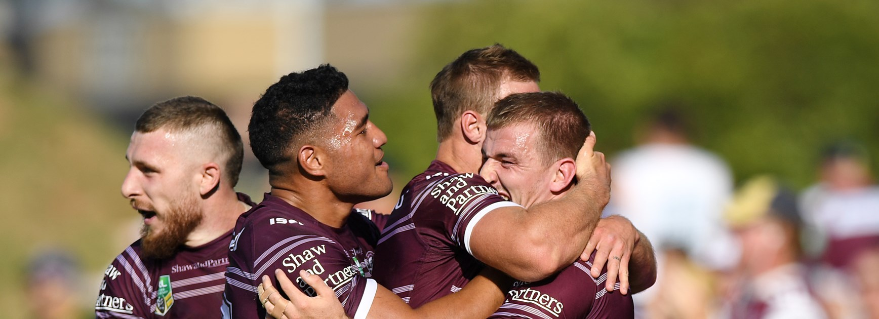 Manly five-eighth Lachlan Croker celebrates with teammates after his try against the Eels.