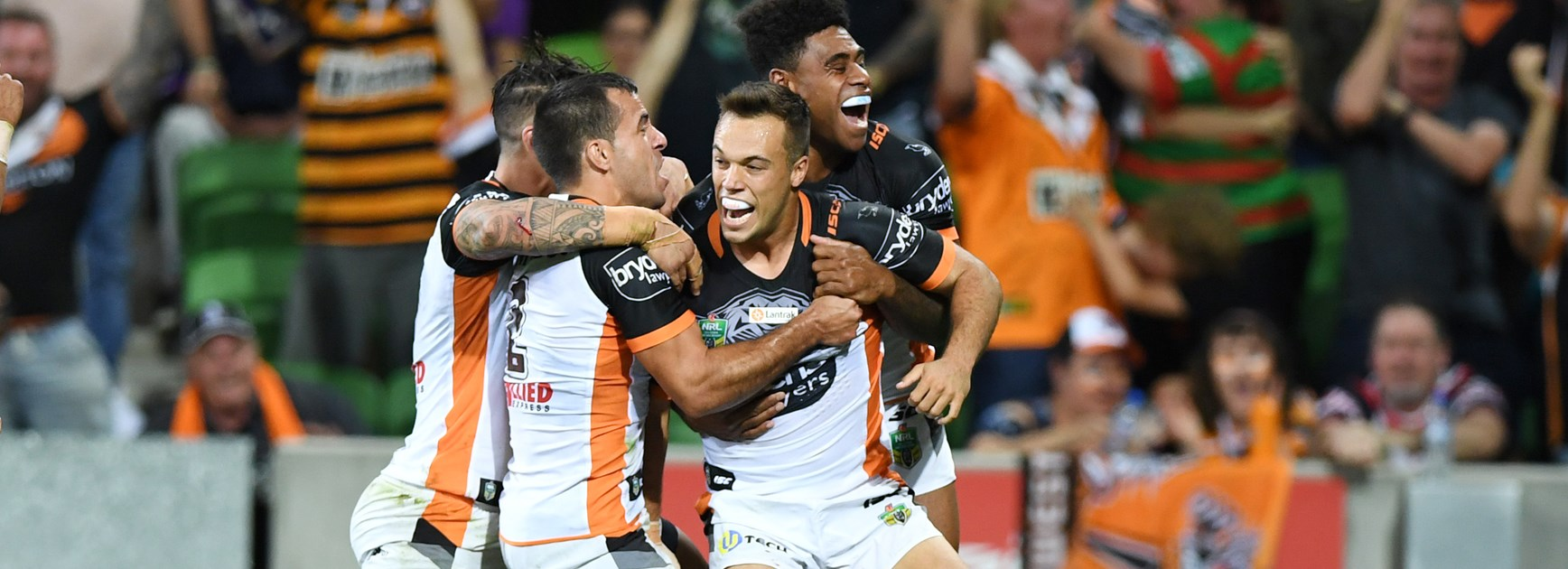 Tigers halfback Luke Brooks celebrates his try against the Storm.