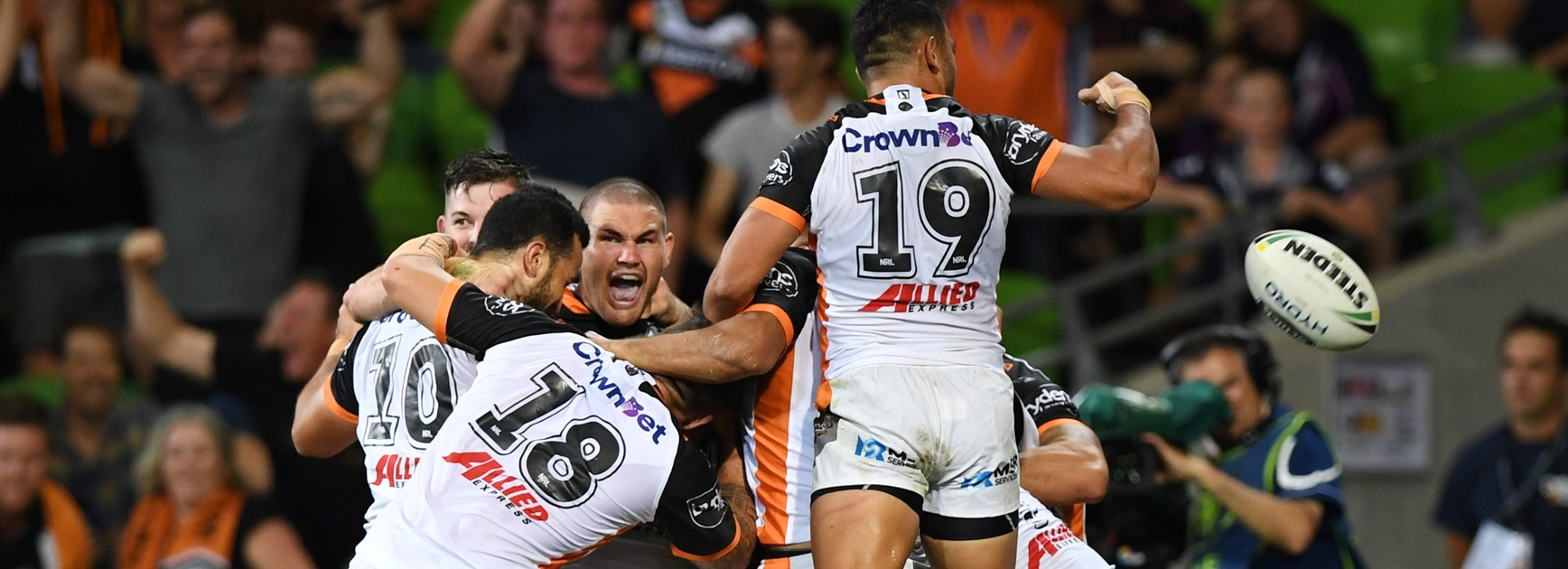 Tigers players celebrate wildly after beating the Storm.