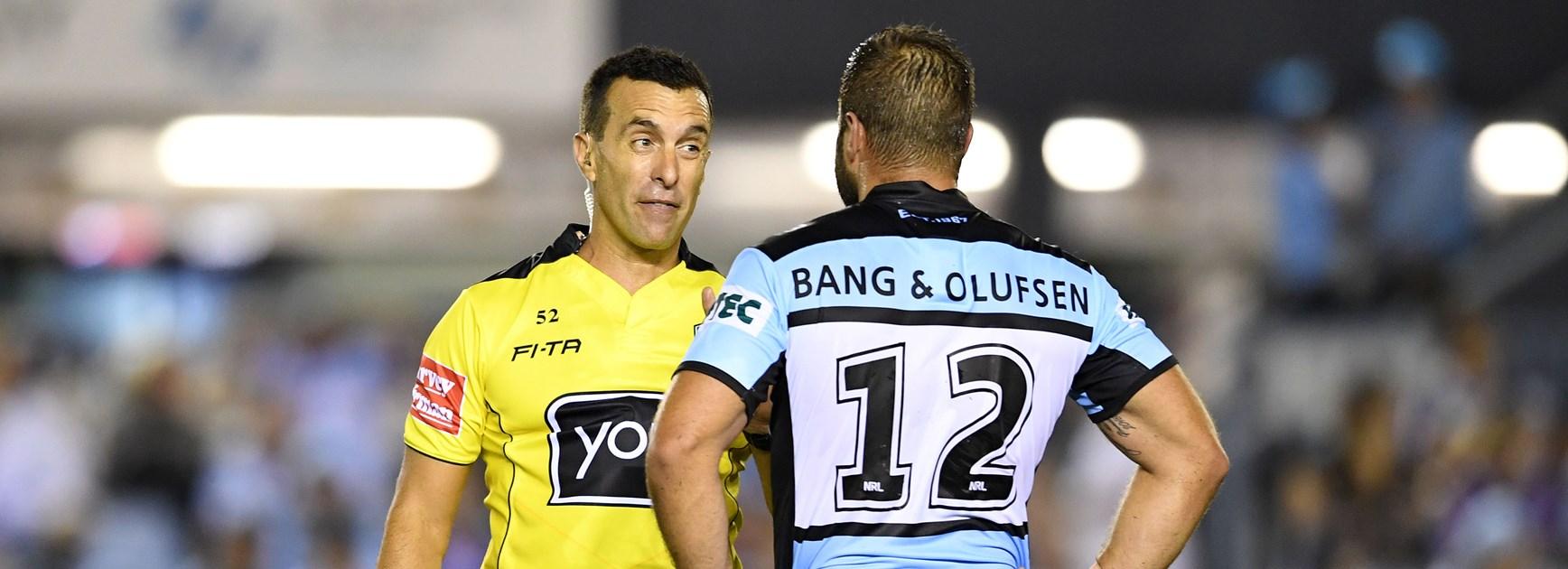 Referee Matt Cecchin and Sharks co-captain Wade Graham.