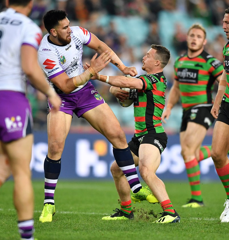 Damien Cook tangles with the much-larger Nelson Asofa-Solomona.