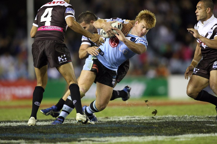 Lance Thompson hits the ball up in his last NRL match in 2008.