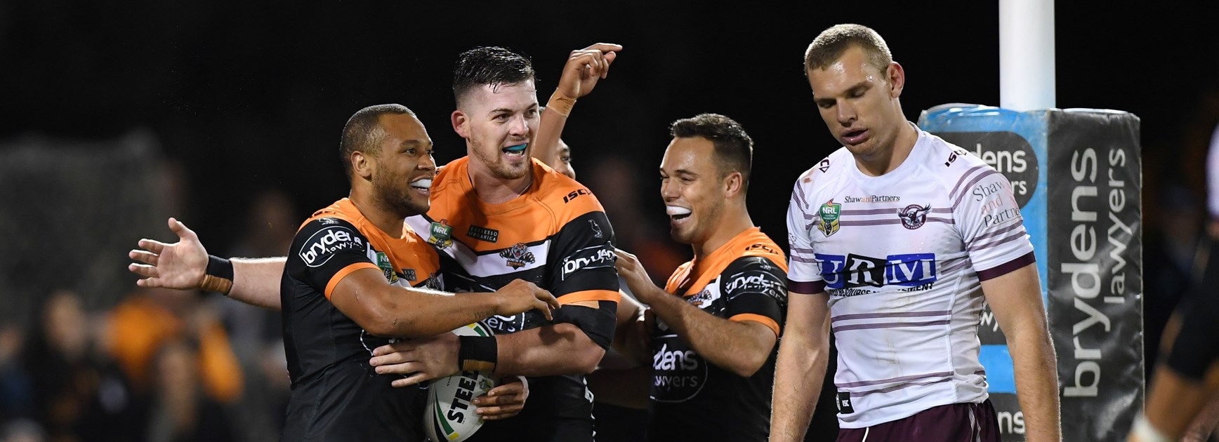 Wests Tigers celebrate Moses Mbye try.