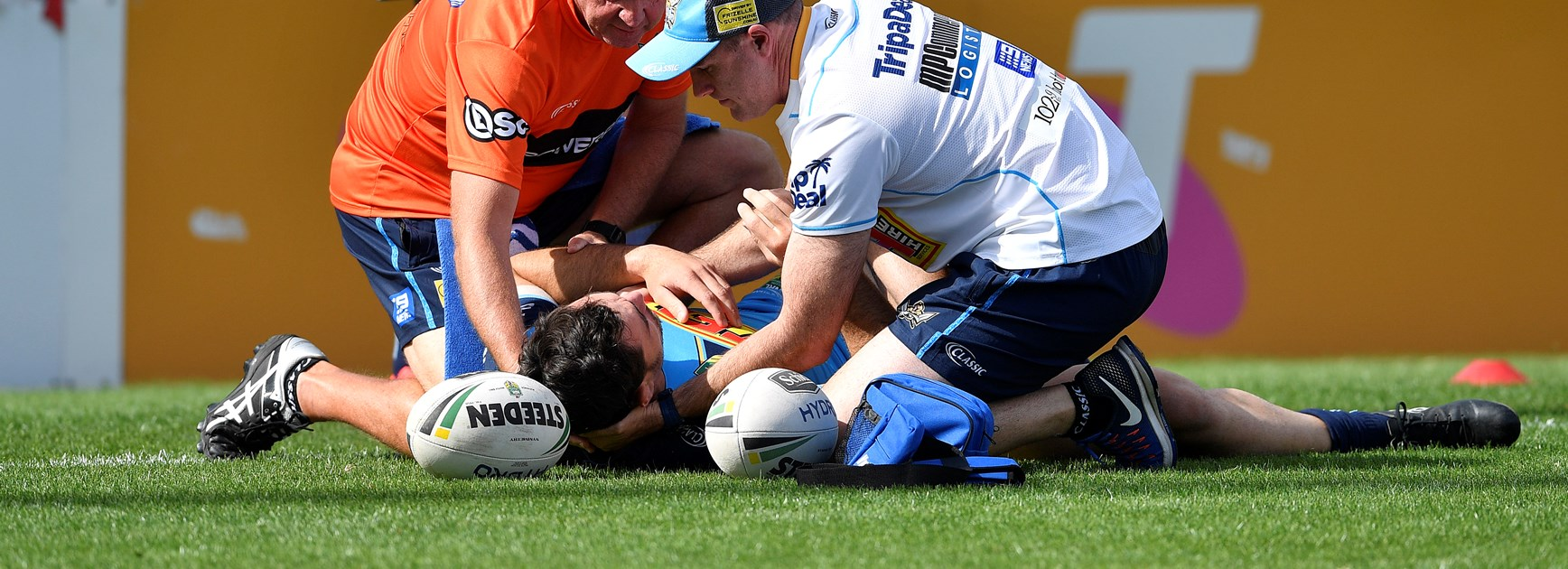 Titans forward Morgan Boyle receives treatment after a head clash with teammate Bryce Cartwright.