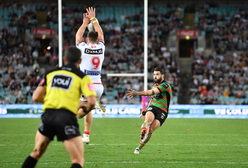 Adam Reynolds just evades the outstretched arms of Cameron McInnes to kick the winning field goal.