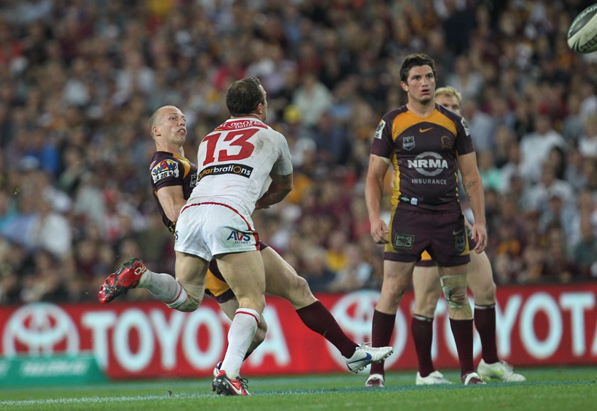 Darren Lockyer kicks the winning field goal against the Dragons in 2011.
