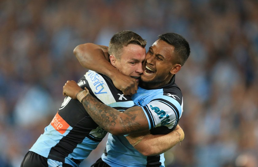 Ben Barba and fellow former Shark James Maloney embrace after the 2016 grand final.
