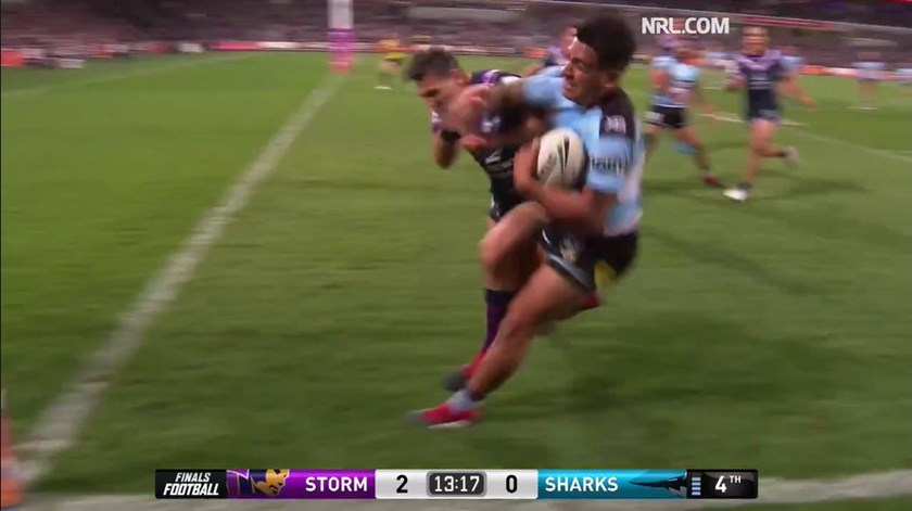 Billy Slater collides with Sosaia Feki.