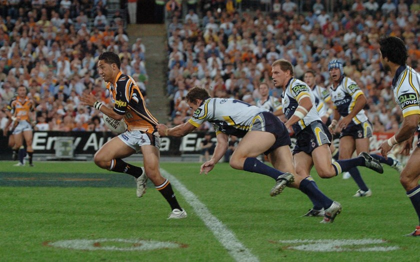 Benji Marshall leaves the Cowboys in his way during the 2005 grand final.
