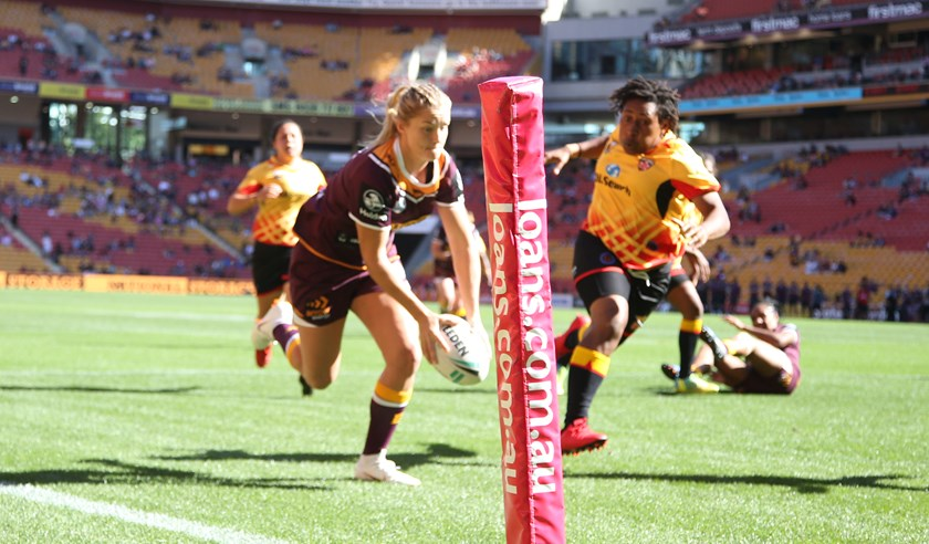 Meg Ward scores for the Broncos against PNG.
