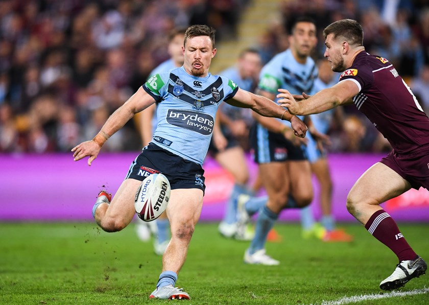 Damien Cook puts in a kick in Game One.