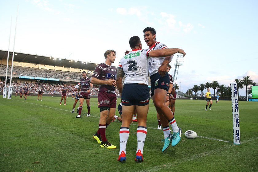Matt Ikuvalu scores for the Roosters.