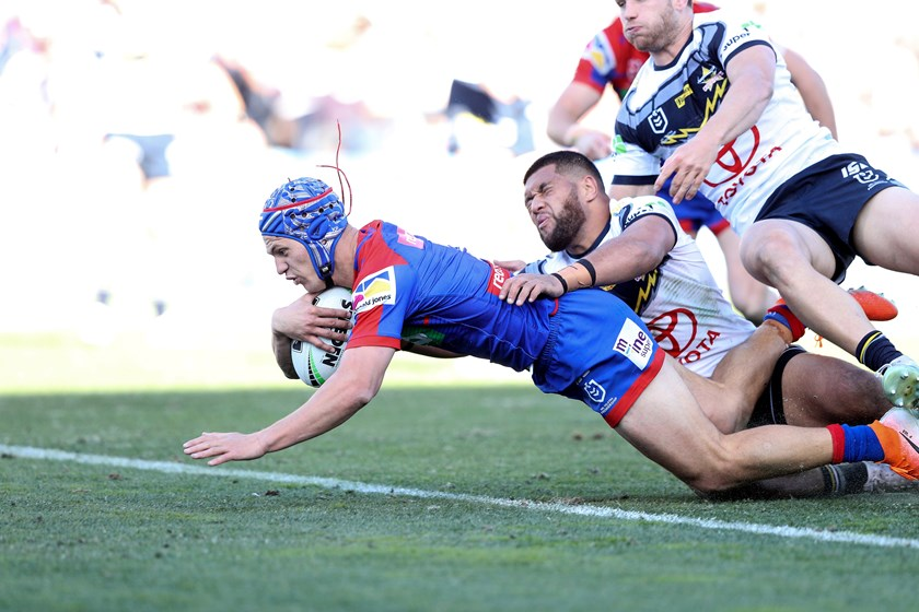 Knights star Kalyn Ponga crosses for a try.