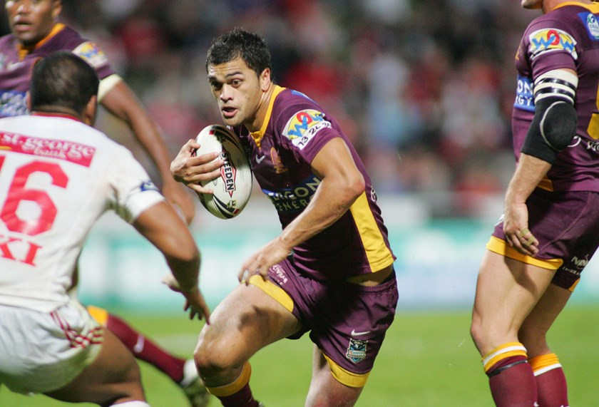 Karmichael Hunt on the fly for the Broncos.