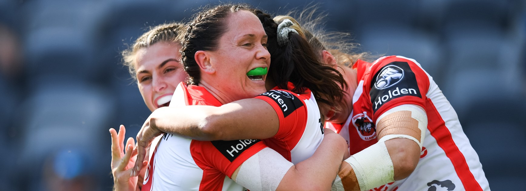 Dragons players celebrate NRLW success.