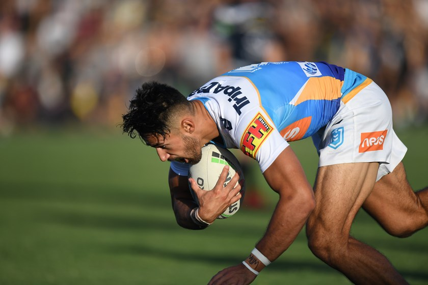 Titans fullback Jesse Arthars scores a try against the Cowboys.