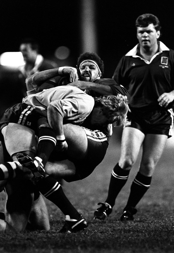 Maroons prop Greg Dowling is tackled.