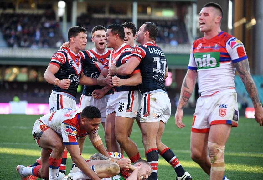 The Sydney Roosters celebrate as Shaun Kenny-Dowell suffers.