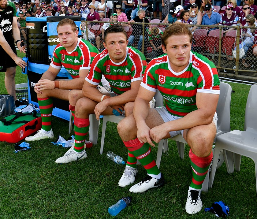 George, Sam and Tom Burgess on the bench during a Rabbitohs game in 2019.