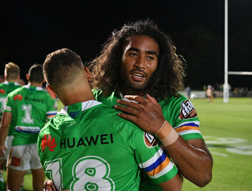 Andre Niko is congratulated after his try.
