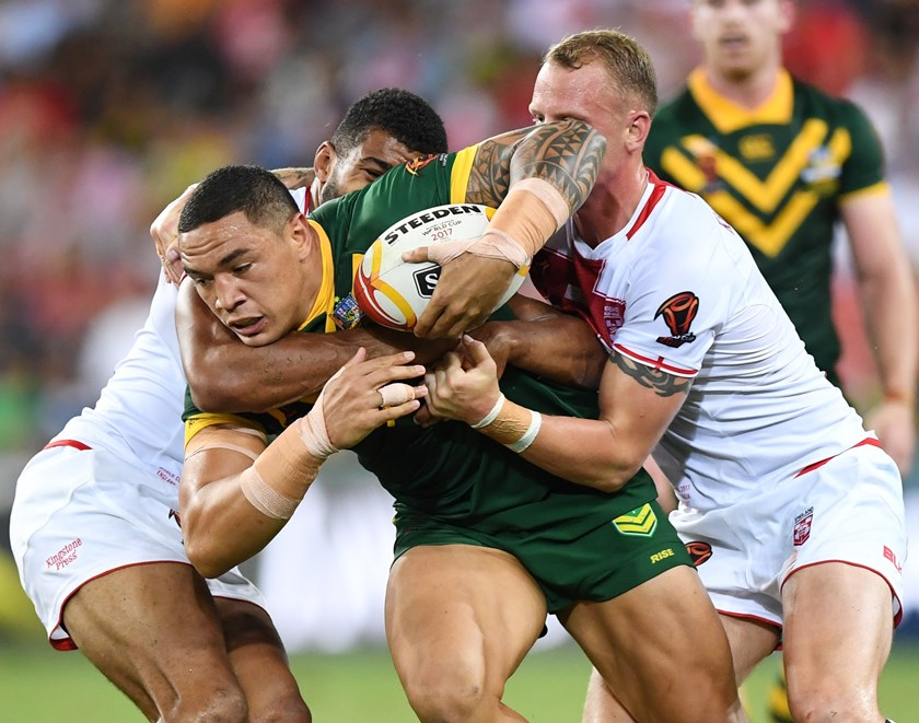 Tyson Frizell is wrapped up by England during the 2017 World Cup final.