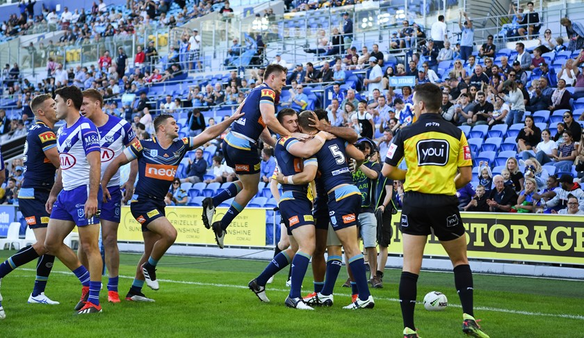 The Titans celebrate a Daly Copley try against the Bulldogs.