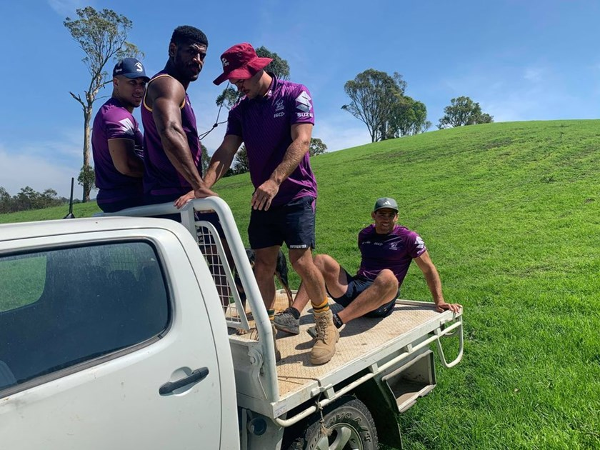 Dale Finucane, Ryan Papenhuyzen, Tui Kamikamica and Aaron Pene offer a helping hand in Bega.